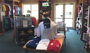 Interior shot of Baytree National Golf Shop showing Shirts Hats and Golf Balls