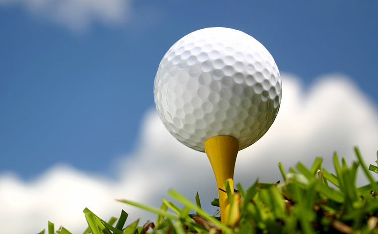 A golf ball sits atop a tee